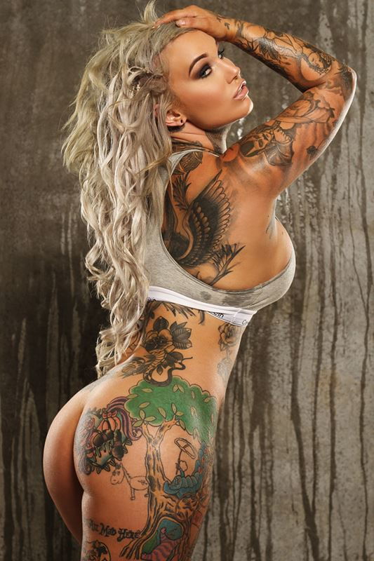 Full body tattoos, hug boobs, XXX Showgirl, stripper